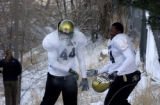 (BOULDER., Colo., Dec. 8, 2005) University of Colorado football players throw snowballs as the...