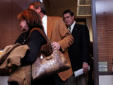 University of Colorado Athletic Director Mike Bohn, right, follows Garry Barnett and his wife Mary...