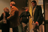University of Colorado Athletic Director Mike Bohn, right, follows Gary Barnett and his wife Mary...