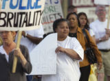 "Denver, Colo., April 16, 2004- Helen Childs walks with a sign that reads ""Stop Killing..."