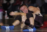 Roosevelt's Danny Frank, top, pins Eaton's Craig Sitzman Thursday night December 8, 2005 at...