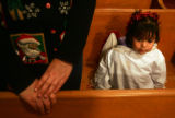 Alexandria Taylor (cq), 2, right, dressed as an angel, sits in a pew next to her grandmother,...