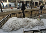 A snowman lies on some tables on the patio of the Hard Rock Cafe Wednesday morning December 7,...