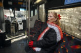 Deborah Davis (cq)sits on an RTD bus after refusing to show her ID to federal police while...