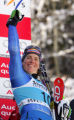 Nadia Styger, of Switzerland, raises her fist after winning the Super G competition in the Women's...