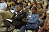 (DENVER, Colo.,  April 14, 2004) Kevin Patterson sits with his son Kyle Patterson in the front row...