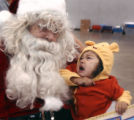Yamilett Nacias (cq) , age 20 months, cries  during her first ever meeting with Santa Claus on...