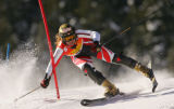 Alexandra Coletti, of Monaco, approaches a gate off-balance on the first run of the Slalom...