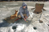 Marv Edwards (cq) 70, and his dog Sparky ice fish at Georgetown Reservoir on Monday December ...