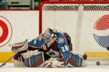 Colorado Avalanche goalie Vitaly Kolesnik lets the second of four unanswered goals past him in the...