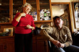 (YUMA., Colo., Dec. 12, 2005) Mary Rogers stands next to her son Kenny Rogers as they talk about...