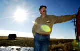 (YUMA., Colo., Dec. 12, 2005) Kenny Rogers leans against his truck, near a piece of property where...