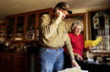 (YUMA., Colo., Dec. 12, 2005) Kenny Rogers and his mother Mary take care of some ranch and farm...