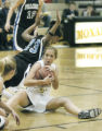 Louisville, CO December 13, 2005 Jade Davis of Highlands Ranch trys to avoid fouling Monarch's...