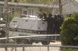 (DENVER, Colo., April 20, 2004) Denver Police SWAT members rode on back of the armored vehicle...