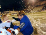 Boise State coach Dan Hawkins tries to escape getting doused with ice water by his players in the...