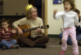 Dylan Berry,3, (cq) claps to the beat while Teedee Keister, 56, (cq), celebrated her birthday like...