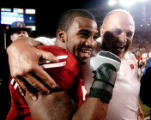 Brian Calhoun and Barry Alvarez celebrate at midfield after the Badger's win. The Wisconsin...