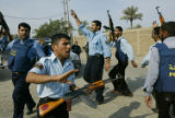(NYT2) BAGHDAD, Iraq -- Dec. 15, 2005 -- IRAQ-2 -- Iraqi policemen sing and dance outside a...