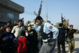 (NYT3) BAGHDAD, Iraq -- Dec. 15, 2005 -- IRAQ-3 -- Iraqi policemen sing and dance outside a...