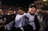 Colorado Buffaloess head coach Gary Barnett is congratulated as he leaves the field after Colorado...