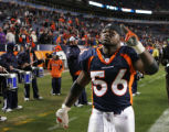 JPM084 - - Denver Broncos linebacker Al Wilson, #56, salutes fans after the Broncos beat the...