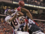 Buffalo Bills defenders Terrence McGee, right, abreaks up a pass intended for Denver Broncos wide...