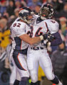 Denver Broncos tight end Wesley Duke is congradulated by teammate Stephen Alexander, left, after...
