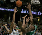 Denver Nuggets guard Andre Miller left, shoots over Boston Celtic center Mark Blount, right, in...