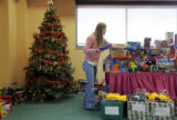 Jessica Lehigh, 15, cq, Centennial, organizes gifts for the Children's Hospital's 9th Annual...