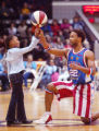 "Harlem Globetrotter #22 Herb ""Flight-Time"" Lang shows Atrionna Minns 7 yrs. how to spin..."