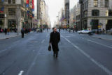 (NYT18) NEW YORK, Dec. 20, 2005 -- NY-TRANSIT-11 -- A pedestrian takes advantage of the closure of...