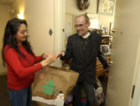 SEASON TO SHARE. Romey Maestas (cq), a volunteer for Project Angel Heart, delivers a meal to James...