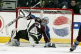 Colorado Avalanche golie David Aebischer, regains his balance after one of his 32 total game saves...