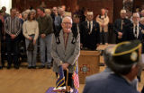 Wayne Dawson (cq), 84, of Sheridan, Colo., stands at a guest of honor at a ceremony held by the...