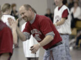 Clark Stukey (cq), right, special education teacher at Chatfield High School and head coach...