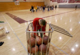 John Black (cq), 16, a sophomore who has Down syndrome, searches for the perfect basketball during...
