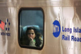(NYT14) NEW YORK -- Dec. 21, 2005 -- NY-TRANSIT-5 -- A commuter looks from the window of a Long...