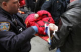 (NYT2) NEW YORK -- Nov. 24, 2005 -- THANKSGIVING-PARADE-2 -- One of two injured sisters is taken...