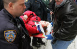 (NYT1) NEW YORK -- Nov. 24, 2005 -- THANKSGIVING-PARADE -- One of two injured sisters is taken to...