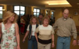 (FT.COLLINS, Colo., April 13, 2004) Bonnie Huff, center with wide stripe shirt,brown on tan on...