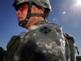 Spc. Ronald Garcia, 21, member of the Army's 3rd Brigade Combat Team, wears kevlar lined shoulder...