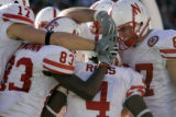 Nebraska Cornhuskers teammates celebrate a touchdown reception by Cory Ross (#4, IB) during the...