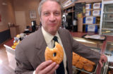 (DENVER, Colo., Apr.14 2004)  Anthony Bonelli, CEO/President, LaMar's Donuts eating one of his...