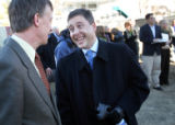 Denver Mayor John Hickenlooper, left, talks with Christian Anschutz before a ground breaking for...