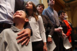 (Denver, Colo., April 21, 2004) Steven Moss, 7, left, looks up at his father, Perry Moss, at the...