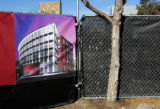 A sign on the edge of the property on 2nd Avenue depicts an image of North Creek, a new mixed use...
