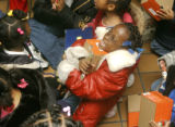 Jalesa Wooten (cq) , age 6, reacts after being given a new pair of shoes at Rose Medical Center...