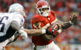 John Sleezer/The Kansas City Star 11/27/05 2005 (With Sports) Chiefs Larry Johnson gains 7 yards...
