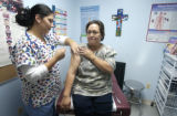 Season to Share  (LT. to RT.) Medical Assistant Nancy Elizondo (CQ), of the Clinica Tepeyac...